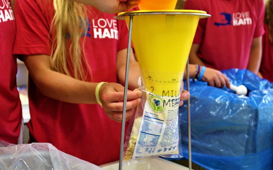 Campers pack 2 millionth meal for Haiti